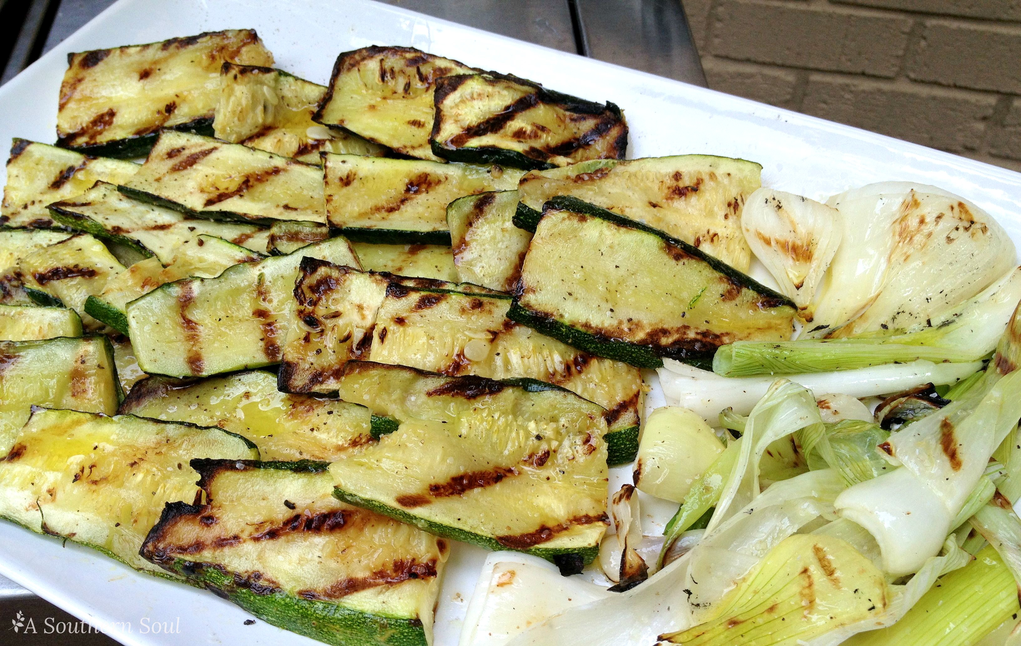 grilled zucchini and onions on platter