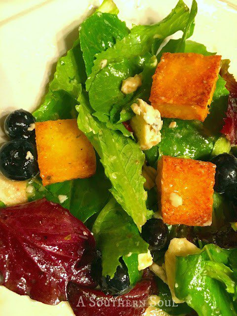 Polenta Croutons with fresh greens & blue cheese
