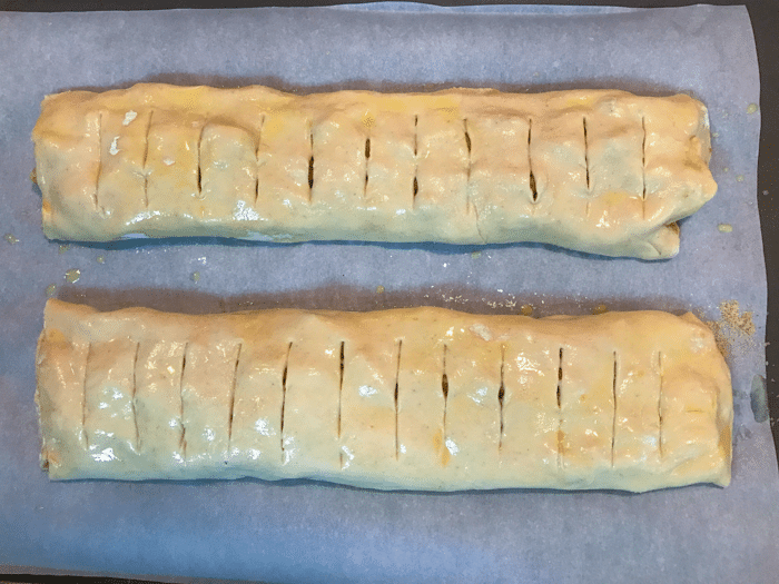 Apple Strudel made with 2 difference kinds of apples, brown sugar and spices then wrapped up in puffed pastry is great for breakfast, brunch or as a dessert!