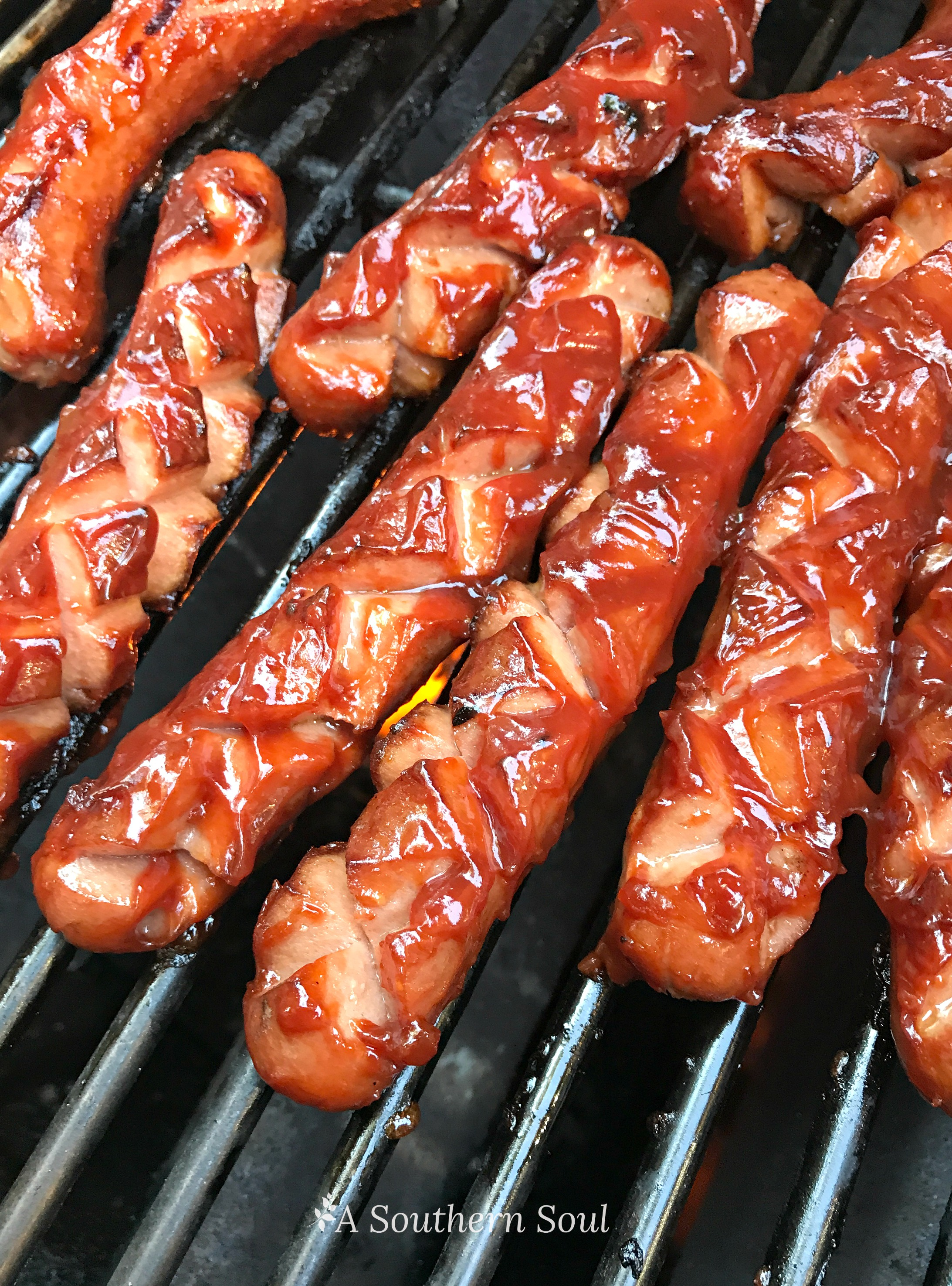 Grilled barbecued hot dogs with homemade sauce