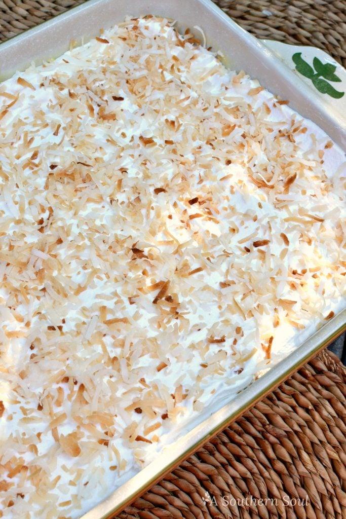 pineapple coconut poke cake in pan