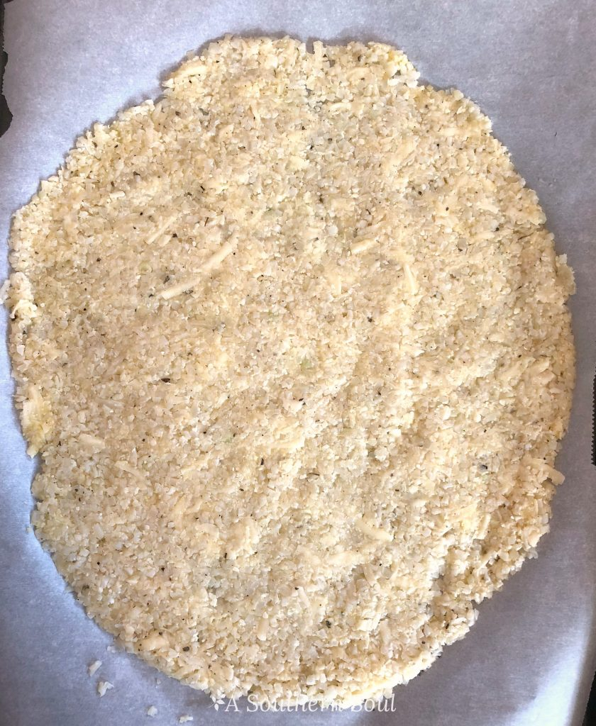 cauliflower crust on pan