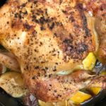 chicken roasted in cast iron with lemon onions and garlic