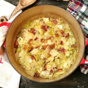fried cabbage and bacon in dutch oven