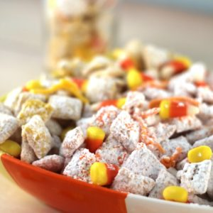Candy corn Muddy Buddy snack mix is loaded with sweetness. It's a crunchy treat that everyone will love.