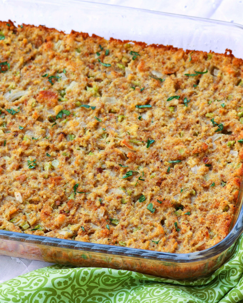 Southern Cornbread Dressing is a classic dish for the holidays. Made with crornbread, biscuits, celery, onion, chicken broth and seasoned to perfection.
