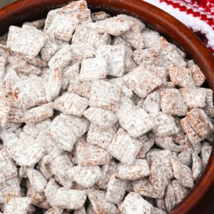 """Classic Muddy Buddies are a """"must make"""" during the holidays. Also know as Puppy Chow, this sweet crunchy treat is a treat loved by kids of all ages!"""