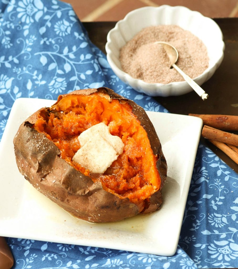 Sweet Potatoes cooked perfectly in the Air Fryer then seasoned with salt and cinnamon sugar along with butter is an amazing easy to make side dish.