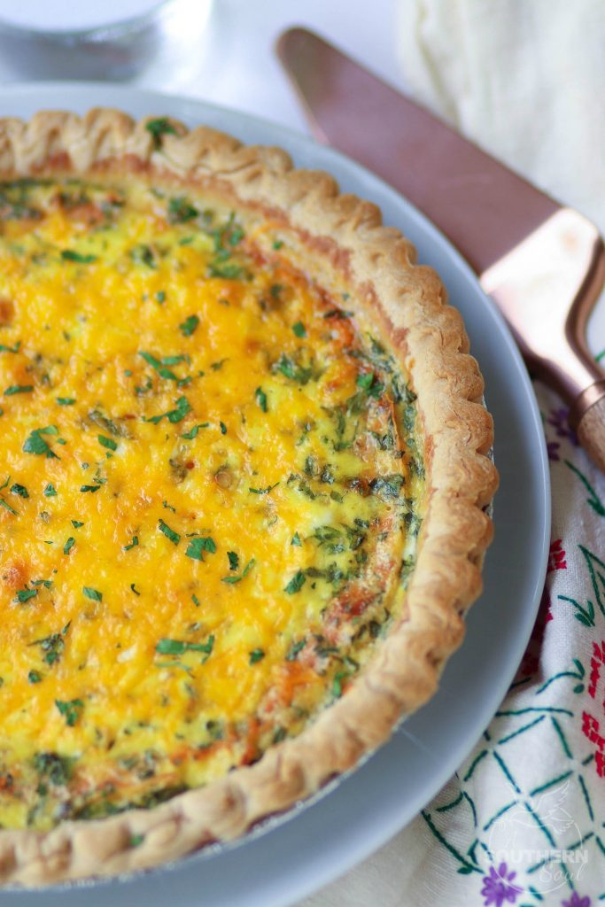 Easy to make Three Cheese Quiche made with cheddar, mozzerella and Parmesan is a great main dish for breakfast, brunch or a weeknight meal.