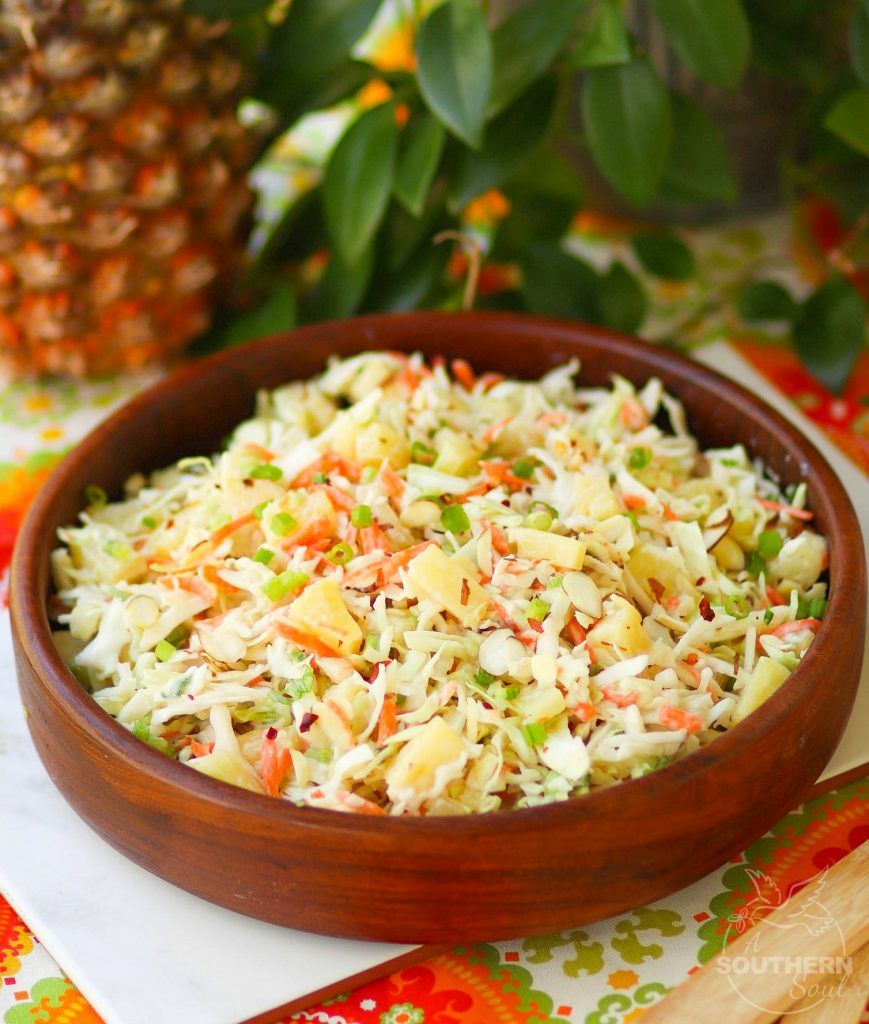 Pineapple Slaw is made with pineapple chunks, bagged cabbage, sliced almonds and green onions with a light, sweet dressing is a side dish that is great for any occasion!