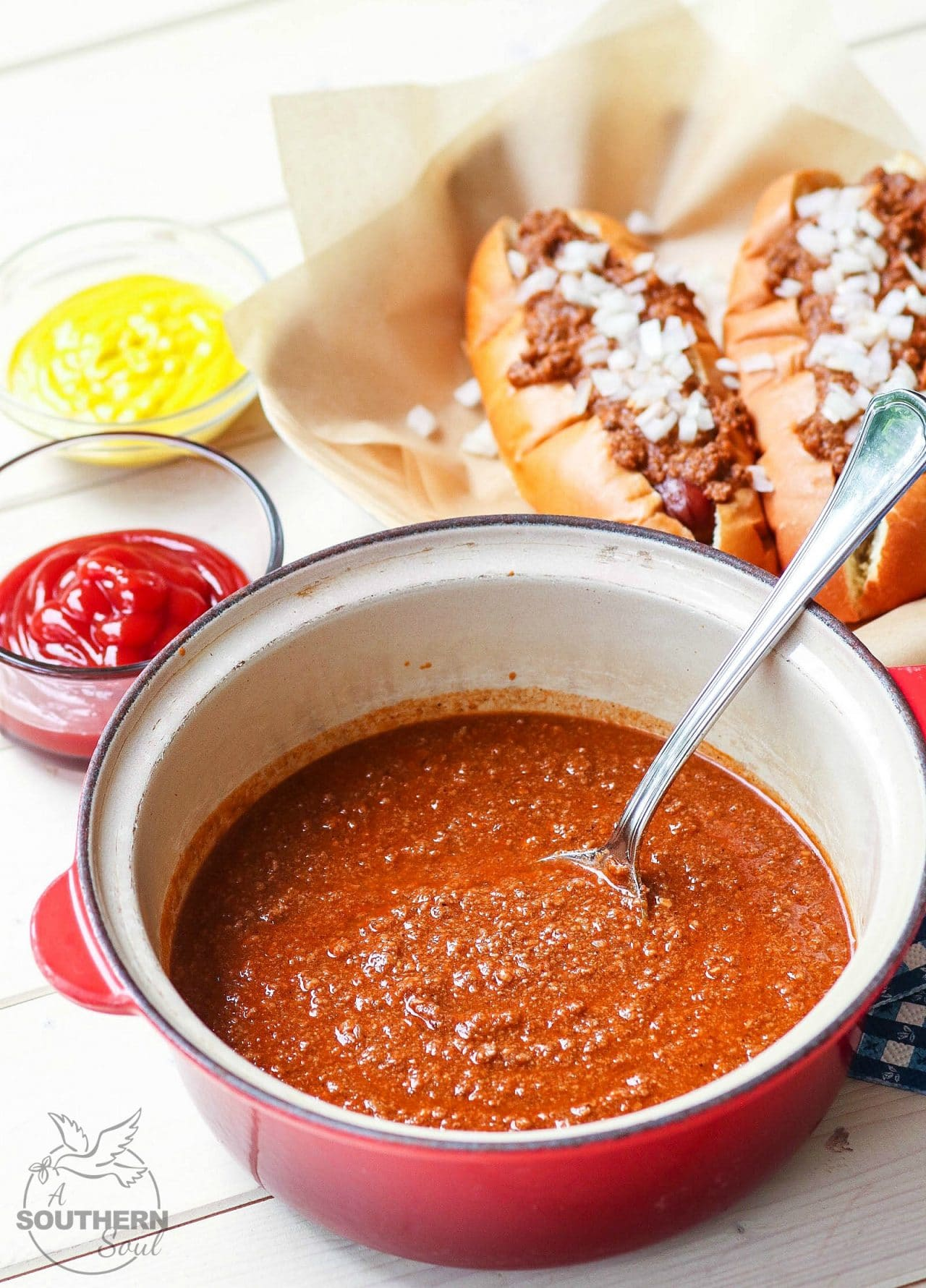 Home Run Hot Dog Chili is the best topping for your grilled dogs. Made with ground beef, herbs and spices for a savory recipe that's easy to make.