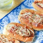 Homemade Meatballs simmered in rich tomato sauce then loaded into toasted sub rolls and topped with cheese. This is a hearty sandwich that's totally irresistible!