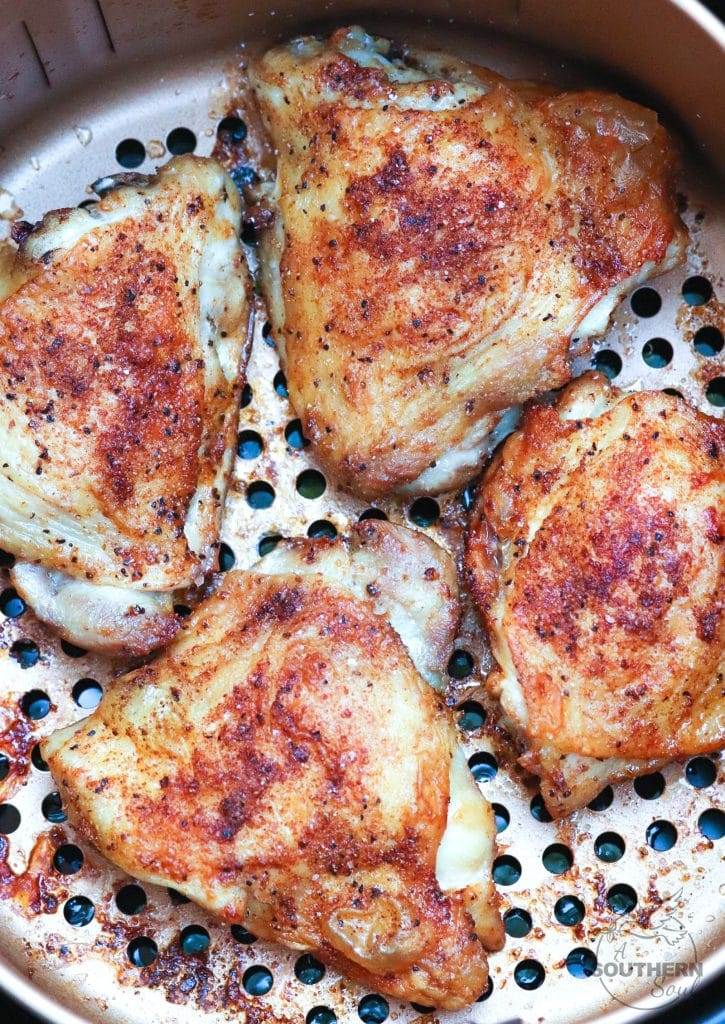 Air Fryer Chicken Thighs with house seasoning, cooked to perfection are juicy on the inside and with a crispy skin!