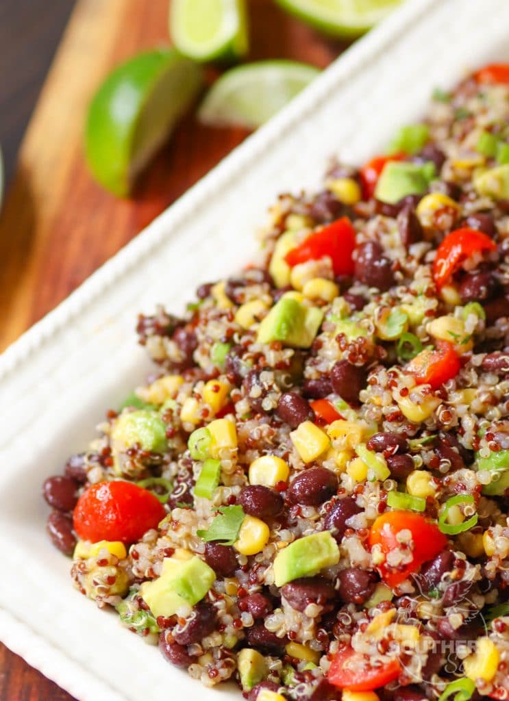 Mexican Quinoa Salad made with quinoa cooked in the instant pot then tossed with tomatoes, black beans, corn, avocado and green onions. A slightly spicy dressing turns the ingredients into a tasty side dish or salad.