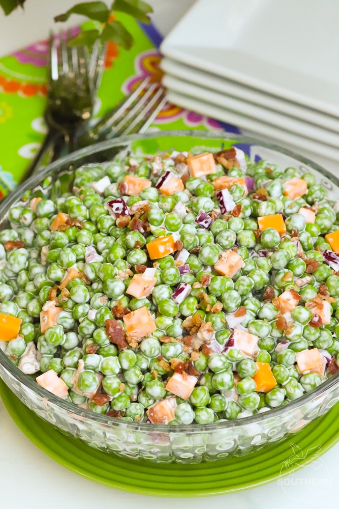 Classic Pea Salad made with thawed peas, cheese, bacon and red onion, then tossed in a creamy, sweet & tangy dressing is a classic side dish that perfect to serve any time of the year!