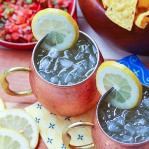 Refreshing lemon shandy made with your favorite beer, lemonade and a twist of lemon is a great drink for summer, tailgating, game day or backyard cookouts.