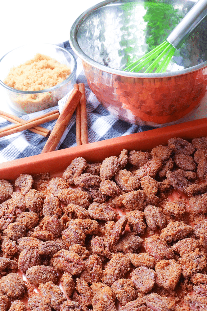 Candied Pecans made with brown sugar, cinnamon, egg whites with a touch of heat are an irresistible treat! As an appetizers, snack or on salads and sides dishes they are delicious. They also make a wonderful homemade gift.