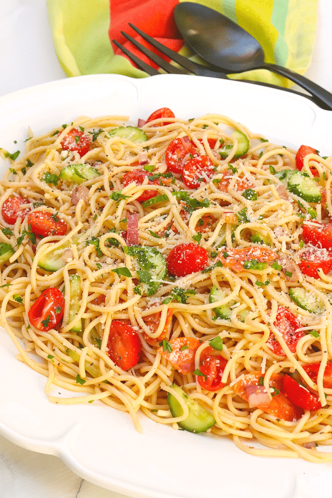 """Spaghetti Salad is the perfect side dish for a party, potluck or when you're feeding a crowd. Made with tender pasta, pepperoni, fresh veggies and tossed in a zesty dressing then topped with Parmesan cheese, this easy to make salad is ideal for """"soup and salad"""" night!"""