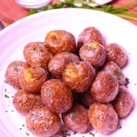 Air Fryer Baby Potatoes are tossed in butter, salt, pepper and parsley for a side dish that's irresistible. Crispy on the outside and soft on the inside these easy to make potatoes are great served for breakfast, lunch or dinner!