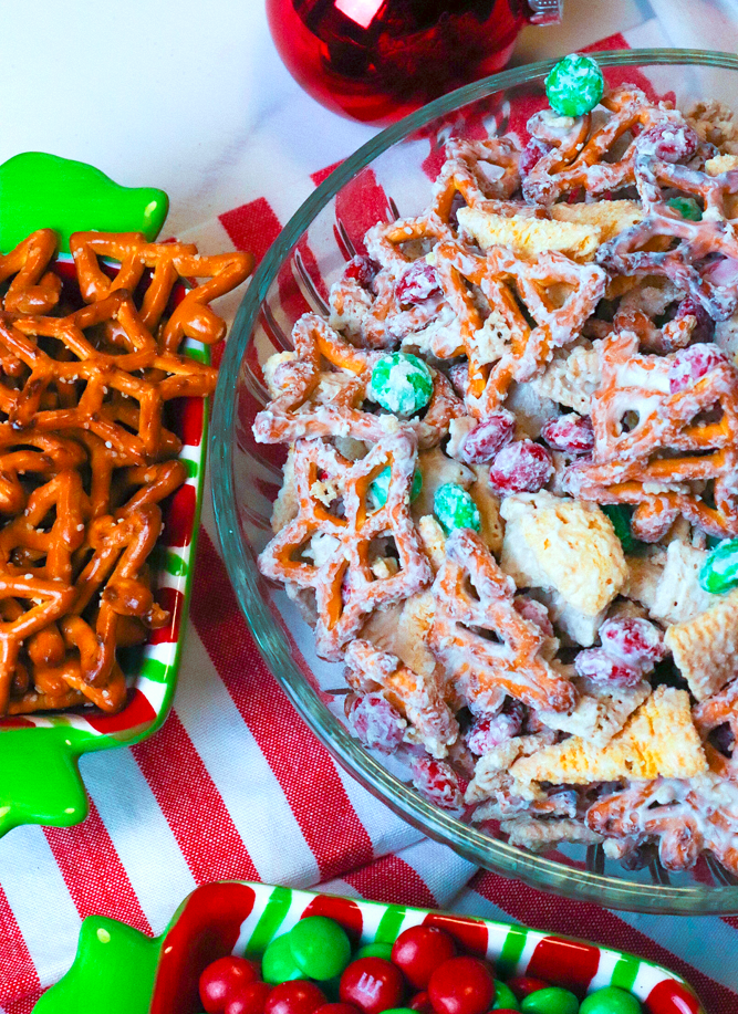 Christmas Snack Mix is a festive blend of rice cereal, pretzels, corn snacks and M&M all coated is a sweet vanilla bark. This easy to make treat is sure to make Christmas extra sweet.