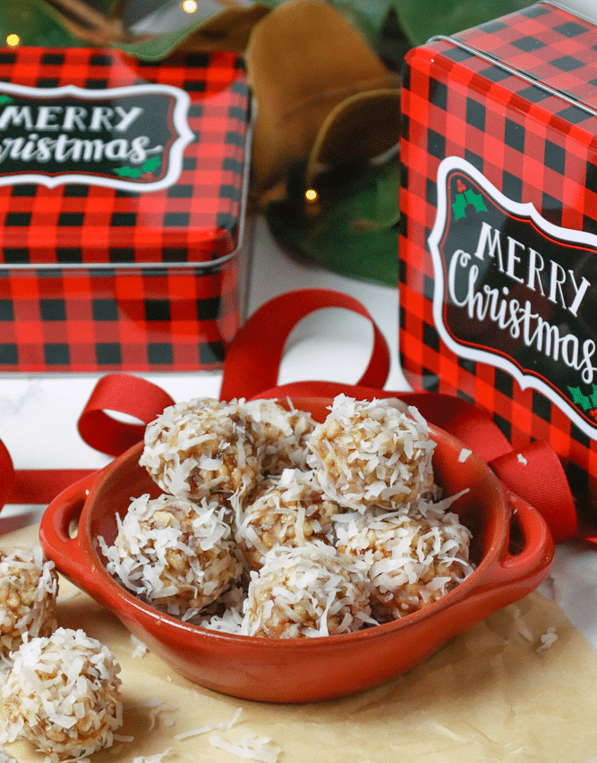 Coconut Date Balls with gift tins are the perfect Christmas treat for friends. A no-bake, easy recipe made with butter, dates, pecans, rice cereal and coconut. This healthy cookie is always a favorite at the holidays.