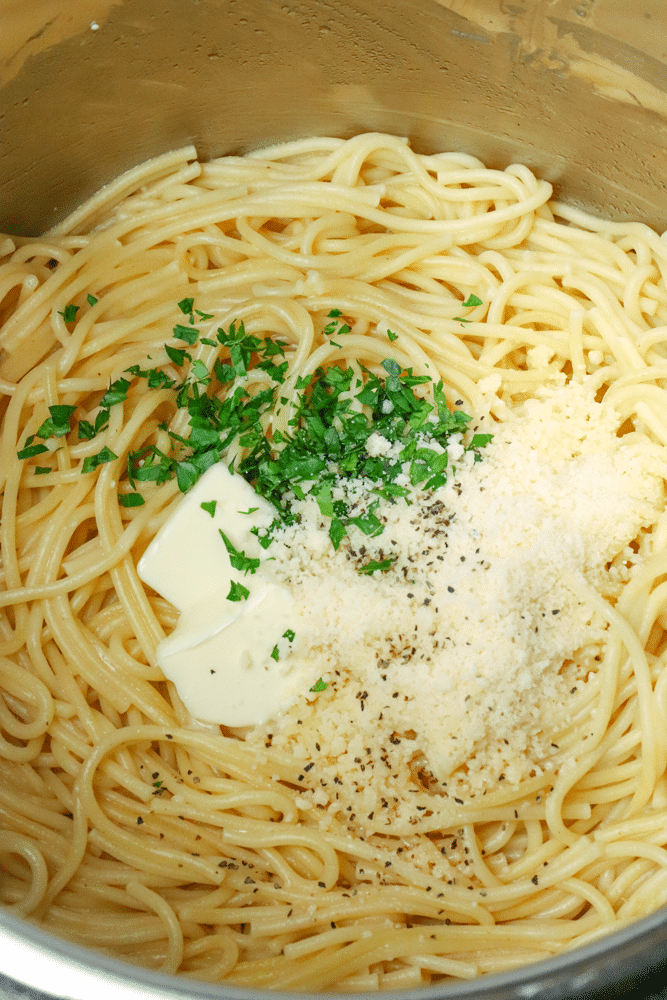 Instant Pot Garlic Parmesan Noodles is comfort food made in 20 minutes. Made with butter, garlic, chicken stock, pasta, Parmesan salt and pepper, this easy recipe is perfect for a week night meal when you've got to get supper on the table in a hurry.
