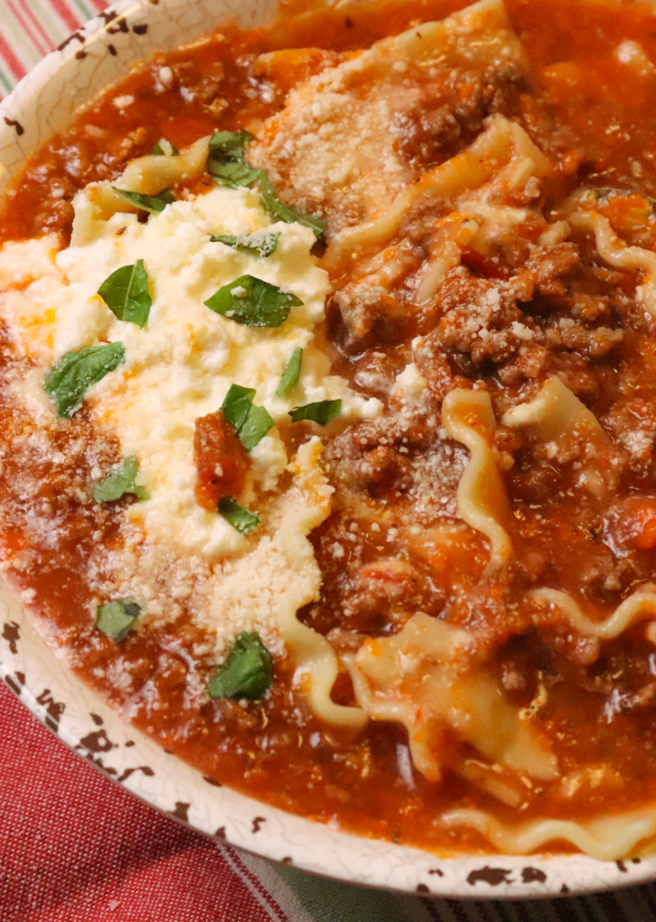 One Pot Lasagna Soup is full of flavor that you love from this classic Italian dish. Made with ground beef, onions, crushed tomatoes, vegetable stock, herbs, lasagna noodles and topped with creamy ricotta and Parmesan.