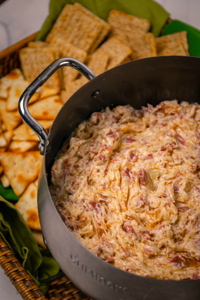 Crock Pot Reuben Dip is so easy to make with just a few ingredients. Make with corned beef, sauerkraut, thousand island dressing and swiss cheese just like the famous, classic sandwich!