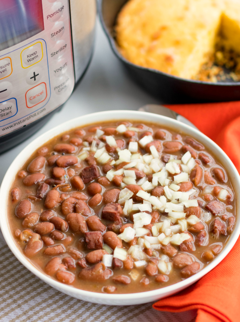 Instant Pot Pinto Beans are so easy to make! Seasoned with ham, onion and garlic then cooked in vegetable stock, this no-soak recipe is great as a main or side dish.