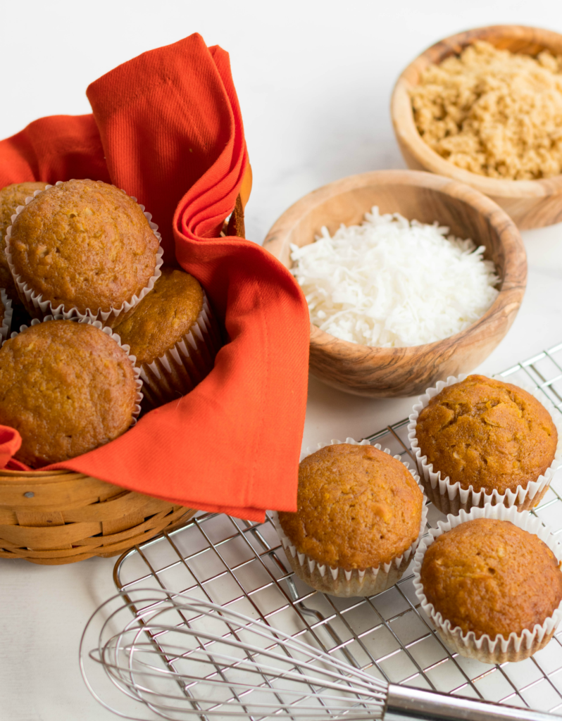 Pumpkin Coconut Muffins are tender, moist and easy to make. These muffins made with canned pumpkin, coconut, flour, brown sugar, cinnamon and nutmeg will soon become your favorite muffin treat perfect for any time of the year.