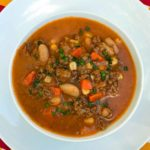 Crock pot beef and bean soup in tomato broth.