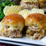 Mississippi Chicken cooked in the crock pot made into sliders with cheese and baked in the voen.