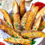 Bowl of potato wedges cooked in the air fryer.