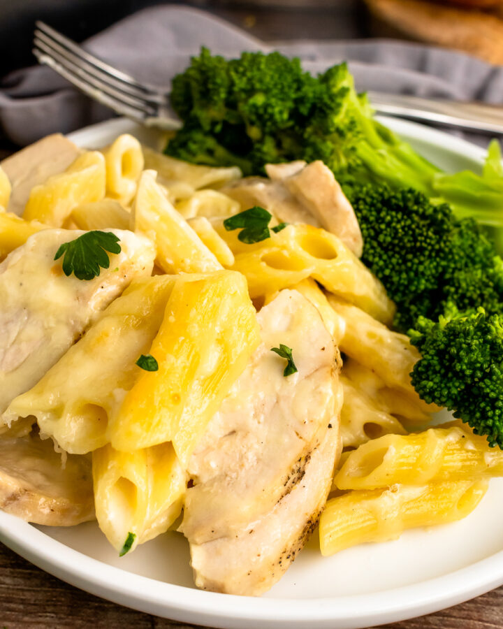 Close Chicken Alfredo Bake with broccoli and a fork.